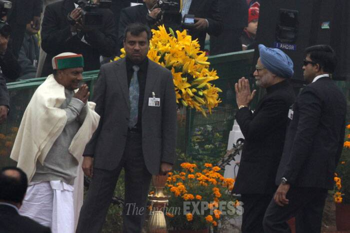 PM Manmohan Singh greets Defence Minister AK Antony. (IE Photo: Amit Mehra)