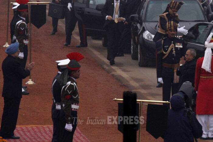 Prime Minister Manmohan Singh welcomes President Pranab Mukherjee at the Republic Day event. (IE Photo: Prem Nath Pandey)
