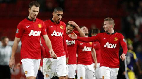 Manchester United players troop off the pitch after their 2-1 loss to Swansea at Old Trafford in the FA Cup (AP)