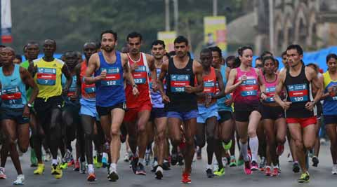 Competitors run during the Mumbai Marathon in Mumbai. (AP photo)