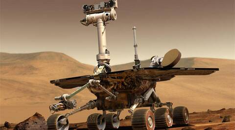 This artist rendering released by NASA shows the NASA rover Opportunity on the surface of Mars. (AP Photo/NASA)