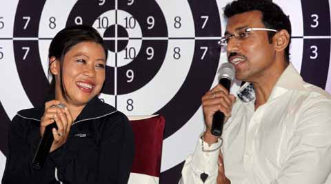 Boxer MC Mary Kom and shooter Rajyavardhan Singh Rathore in Kolkata Thursday. PTI