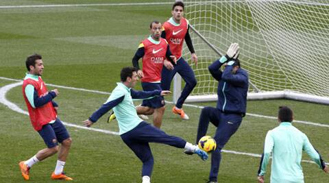 Lionel Messi shoots the ball to goalkeeper Jose Pinto during an open training session at Mini stadium in Barcelona (Reuters)