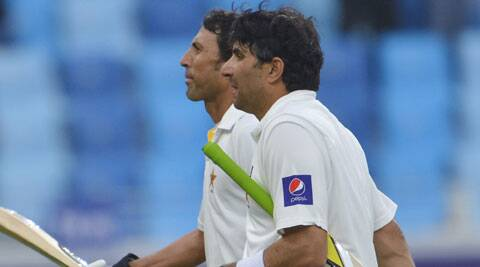 Misbah leaves the ground with Younis during the second Test match between Pakistan and Sri Lanka (AP)