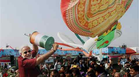 Narendra Modi flies a kite during the 26th International kite festival in Ahmedabad on Sunday. (PTI)