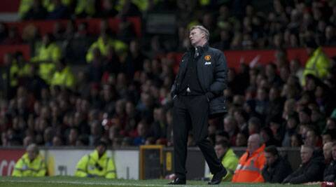 David Moyes watches as his team lose 2-1 to Swansea City in their English FA Cup third round soccer match at Old Trafford (AP)