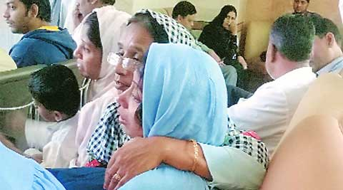 Fatema Jawadwala grieves for her 15-year-old son Husain, who died at the stampede at Saifee Mahal. Express