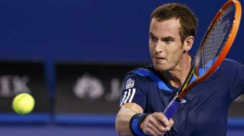 Andy Murray of Britain hits a return to Vincent Millot of France during their men's singles match at the Australian Open 2014 (Reuters)