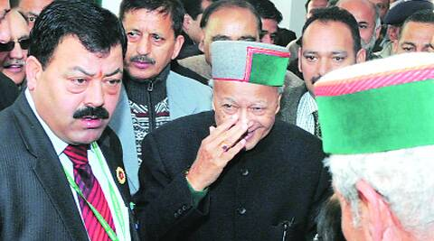 Chief Minister Virbhadra Singh leaves after filing defamation cases at a Shimla court Thursday. (Lalit Kumar)