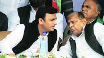 Akhilesh Yadav with father and party chief Mulayam Singh Yadav at the rally, in Varanasi on Thursday. Express
