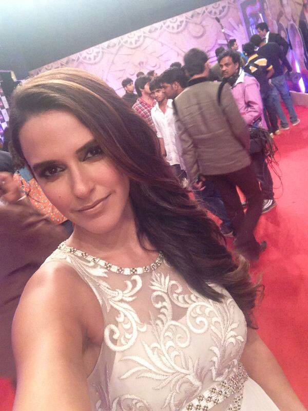 Neha Dhupia looks lovely in white lace as she pouts for a red carpet selfie at the Life OK Screen Awards.