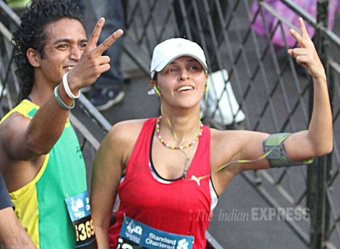 Actress Neha Dhupia cheers the participants of Mumbai Marathon. (IE Photo: Deepak Joshi)