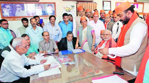 Shambhuprasad Tundiya submits his nomination papers for RS election in the presence of Narendra Modi in Gandhinagar on Tuesday. (PTI)