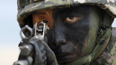 South Korean Marine takes position during the joint military exercises between South Korea and the United States called Ssangyong 2013 as a part of annual Foal Eagle military exercises in Pohang, south of Seoul, South Korea.