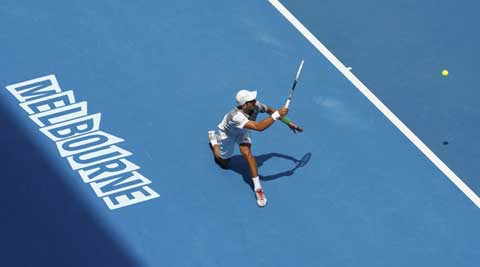 Novak Djokovic of Serbia hits a return to Leonardo Mayer of Argentina during their men's singles match at the Australian Open 2014 (Reuters)