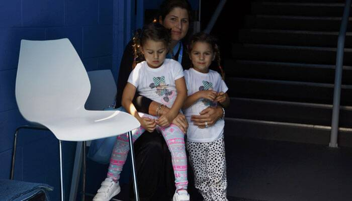 Federer, who next plays Jo-Wilfried Tsonga, had his entire family to support him at the Rod Laver Arena in Melbourne Park on Saturday. Federer's twin daughters were accompanied by their mother Mirka Vavrinec. REUTERS