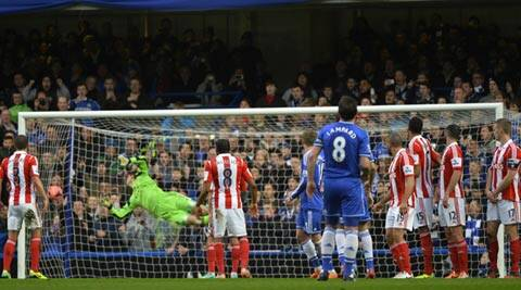Chelsea's Oscar (not pictured) scores from a free kick during their FA Cup soccer match against Stoke City at Stamford Bridge (Reuters)