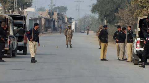 Pakistani police and army soldiers cordon off a road leading to the site of bomb explosion in Bannu. (AP Photo)
