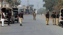 Pakistani police and army soldiers cordon off a road leading to the site of bomb explosion in Bannu, Pakistan. (AP)
