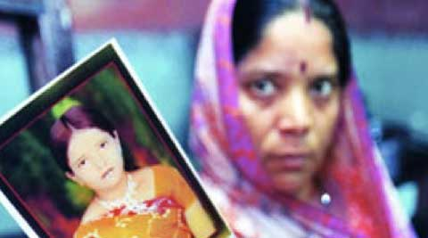 Sushma Pandey's mother with Sushma's photo.