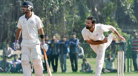 Parvez Rasool took (right) took 27 wickets and scored 663 runs (including two hundreds) for Jammu & Kashmir in the 2013-14 Ranji Trophy (File)