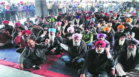 PAU employees protest outside Thapar Hall on Tuesday.