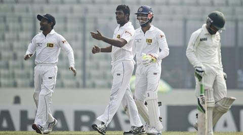 Sri Lanka's Dilruwan Perera, second left, celebrates the wicket of Bangladesh's Mominul Haque, right on the fourth day (AP)