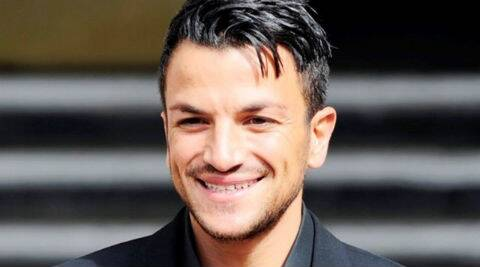 Peter Andre had a special engagement ring made for Emily. The diamond band took six weeks to complete. (Reuters)