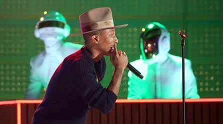 Pharrell Williams performs with Thomas Bangalter, background left, and Guy-Manuel de Homem-Christo of Daft Punk, at the 56th annual Grammy Awards. (AP)