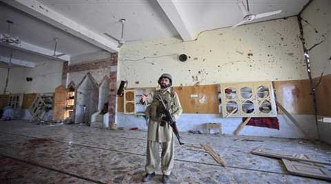 A paramilitary soldier secures the site of a sucide bomb attack. Reuters