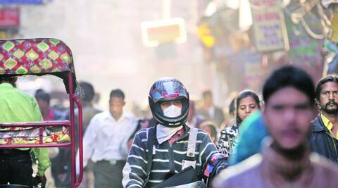 Guarding against pollution at Paharganj, one of Delhi's densest areas.File photo