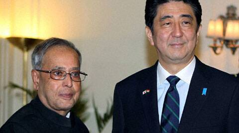 President Pranab Mukherjee shakes hands with Japanese Prime Minister Shinzo Abe during a meeting at Rashtrapati Bhavan. (PTI)