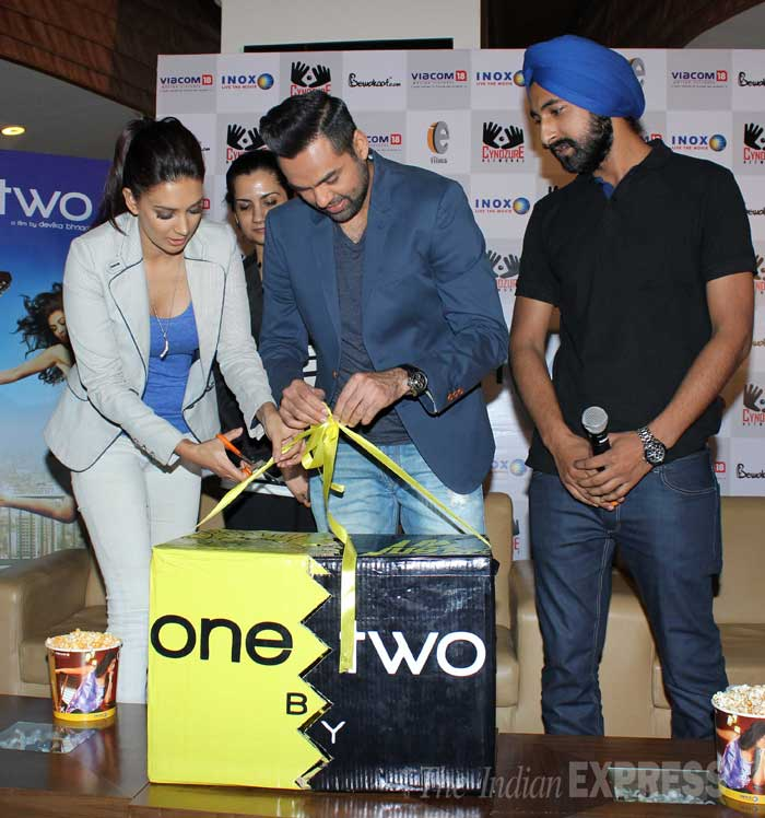 Preeti and Abhay snip the ribbon holding all the goodies. Seen here with their director Devika.  (Photo: Varinder Chawla)