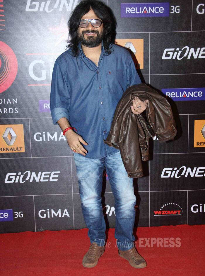 Music director and composer Pritam smiles for the shutterbugs. (Photo: Varinder Chawla)