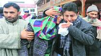 Relatives of assistant sub-inspector Kafeel Ahmed in Srinagar. IE: Shuaib Masoodi