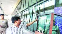 Airport director Manoj Kumar Gangal shows the bullet-proof glass security cabins recently installed at the entrance as part of the Modernisation of Airfield Infrastructure project. 	Sandeep Daundkar