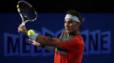 Rafael Nadal of Spain hits a return to Thanasi Kokkinakis of Australia during their men's singles match at the Australian Open 2014 (Reuters)