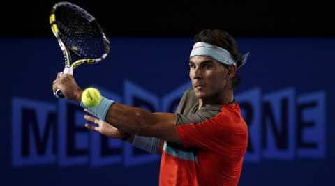 Rafael Nadal of Spain hits a return to Thanasi Kokkinakis of Australia during their men's singles match at the Australian Open 2014 (Reuters)