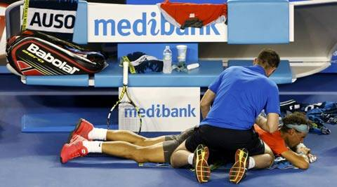 Rafael Nadal of Spain receives treatment during his men's singles final match against Stanislas Wawrinka (Reuters)