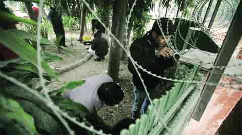 Officials at the crime scene, in New Delhi on Wednesday.(Photo: Praveen Khanna )