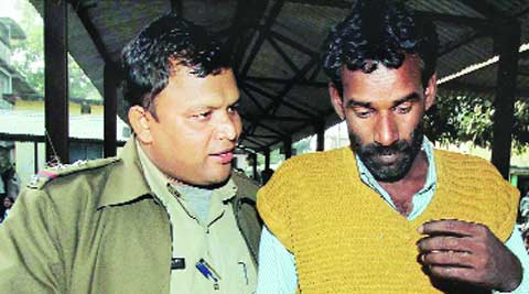 Police takes away Khalek Sk, lover of victim, who was produced in court in Birbhum, Tuesday. (PTI)