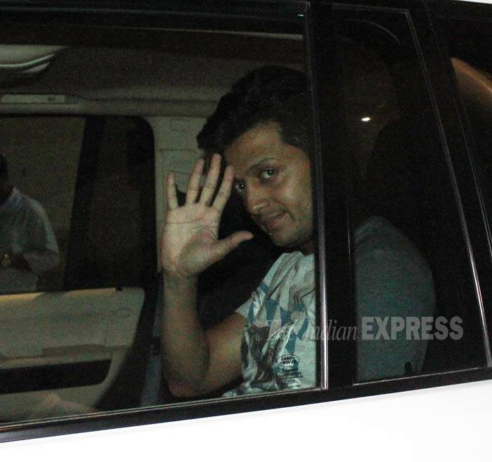 Her co-star Riteish waved to the cameras as he left in his vehicle. (Photo: Varinder Chawla)