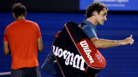 Roger Federer of  Switzerland, right,  walks off the Rod Laver Arena after his semifinal loss to Rafael Nadal of Spain, left,  during their semifinal at the Australian Open (AP)