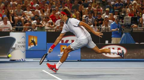 Roger Federer of Switzerland hits a return to Blaz Kavcic of Slovenia during their men's singles match at the Australian Open 2014 (Reuters)