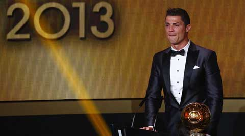 Cristiano Ronaldo reacts after being awarded the FIFA Ballon d'Or 2013 in Zurich January 13, 2014. Portugal and Real Madrid forward Cristiano Ronaldo was named the world's best footballer for the second time on Monday (Reuters)