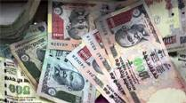 Rupee drops 12 paise against dollar in late morningtrade