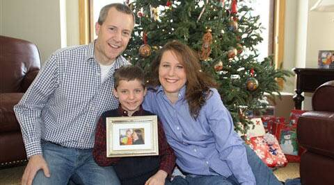 A December 2012 photo shows John, Jack and Renee Thomas at their home in Minnetrista, Minn. Jack was adopted from Russia in 2008.