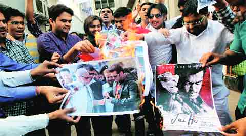 NSUI workers burn photos of Narendra Modi, Salman Khan and posters of Jai Ho in Ahmedabad Wednesday.