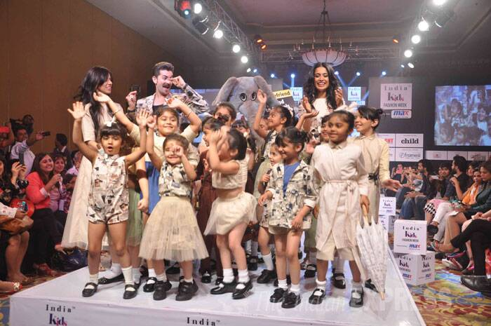 Actors Neil Nitin Mukesh and Sarah Jane Dias walked the ramp hand-in-hand with tiny tots at the India Kids Fashion week in Mumbai on January 19. Neil and Sarah-Jane join the kids on the ramp along with a friendly elephant. (Photo: Varinder Chawla)