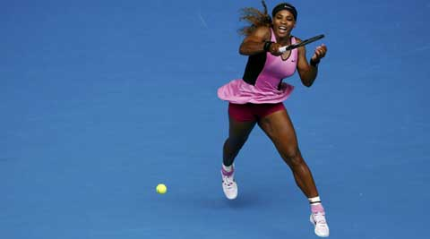 Serena Williams of the U.S. hits a return to Vesna Dolonc of Serbia during their women's singles match at the Australian Open 2014 (Reuters)